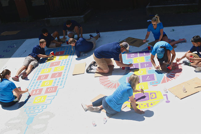 160 Bain Capital Credit employees join City Year at the William E. Russell Elementary School in Dorchester for a day of service